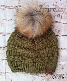 IN OLIVE A little twist on the popular CC beanie hats - a faux fur pom pom on top!  Available in 20 fabulous colors - the perfect winter accessory!  100% Acrylic, one si