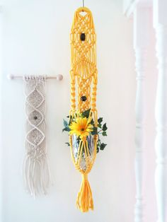 This macrame wall hanging planter is handcrafted in my smoke free home and is made-to-order. This listing is for one macrame plant hanger. It measures approximately 34 and you can choose from many different colors. This colorful plant hanger is made with 6mm craft poly cord and has two