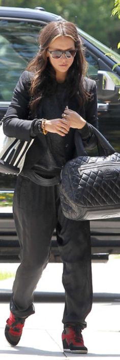 Who made Jennifer Love Hewitt's red wedge sneakers, black sunglasses, and handbags that she wore in Los Angeles? Sunglasses – Ray Ban  Purses – Chanel  Shoes – Ash