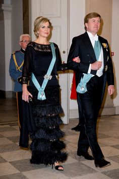 Queen Maxima gets an honourable mention, for her's is quite small but made up of large diamonds. Her black lace and feather fringe dress is also quite chic.: [object Object]