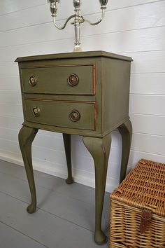 This stylish bedside table has been hand painted in Annie Sloan Olive with drawers accentuated in Barcelona Orange.   We love the handles and curved legs on this vintage beauty!