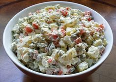 Russian Potato Salad is another name for Stolichniy Salad (Capital Salad), which  is a variation of Olivier Salad. It was created in the 1860s by a Russian chef of Belgian origin (who might have been French), Lucien Olivier, the chef of the prestigious Hermitage restaurant in Moscow. The salad quickly became a staple at the restaurant, and nowadays is popular not only in Russia, but in many other countries.