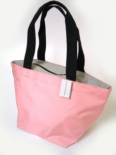 Herve Chapelier totes. We have these in every color and many sizes....size does matter..lol, and Pink is Ok!!