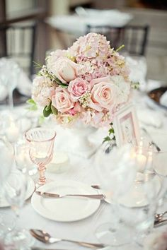 There is going to be a gorgeous round floral centerpiece sitting in my white vintage milk glass vase on the guest table .