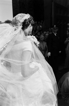 Future US First Lady Jacqueline Kennedy (1929 - 1994) (in a Battenburg wedding dress) arrives at St Mary's Church for her wedding to John F Kennedy, Newport, Rhode Island, September 12, 1953.