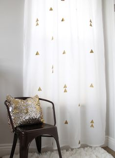 Metallic twist - add gold vinyl iron-on shapes / 15 IKEA Hacks to Dress Up Your Windows via Brit + Co.