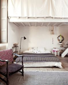 love the idea of curtains over the loft railing in a tiny house.