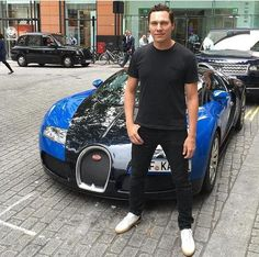Posing in front of exotic cars always gets lots of likes so that's what I am going for here Tiësto, July 2016