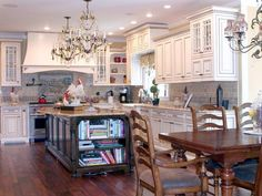 European-Style Kitchen With Chandeliers >> http://www.diynetwork.com/kitchen/kitchen-chandeliers-pendants-and-under-cabinet-lighting/pictures/index.html?soc=pinterest#