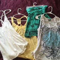 Tank Top Bundle White Racer Back- Maurice's- Large. Yellow Racer Back- JC Penny's- Large. Green Tube Top- Rue 21- XL. White Tribal Tank- Dots- Large Tops Tank Tops