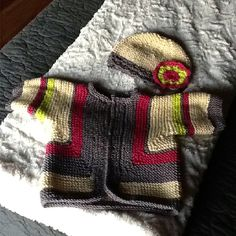 Elizabeth Zimmerman's baby surprise sweater and Ericka Knight's baby bonnet for Peyton.