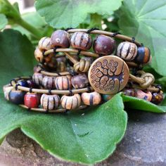 Czech glass and leather wrap bracelet with tree of life clasp.