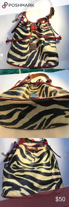 Dooney & Bourke Zebra Print Satchel with Red Trim Dooney & Bourke Zebra Print Satchel with Red Trim. Signs of wear as pictured. Used condition; no rips or tears. Beautiful well-loved bag❣️ Please don't be shy! Feel free to make a ridiculous offer! I won't be offended. I promise! I might counter, and I just might accept, depending on my ever changing mood! God Bless❣️ Happy Poshing❣️ Dooney & Bourke Bags