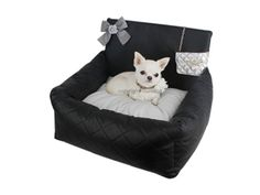 """Ensemble of Gorgeous & Luxurious  - Covered with Black quilted faux leather  - Chain bag & Ribbon ornament adds gorgeous look to it  - Possible to store small object like Cell Phone in Chain bag Ornament  - Single zipper makes it easy to carry and store  - Double-sided cushion (Cotton & Soft faux fur)  - Easy to install & secure by fastening a seat belt - Available 2 sizes: Petit and Grand """"Don't let you furry friends ride without the Driving Kit!"""""""
