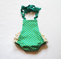 The sweetest summer outfit for your sweetest girl! This vintage style one-piece is 100% cotton, and has adjustable straps that tie in back for longer wear. Elastic at back keeps the fit snug. Snaps at crotch make for easy diaper changes.     This listing is for the turquoise polka dot sunsuit. Ru...