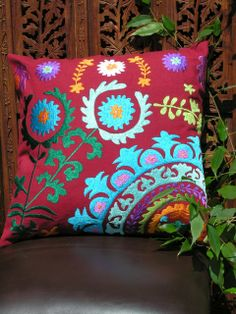 Suzani embroidered cushion in red with a flower design