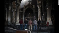 Iraqi Christians pray Saturday, November 12, at the Church of the Immaculate Conception, which was damaged by ISIS militants during their occupation of Qaraqosh, Iraq.