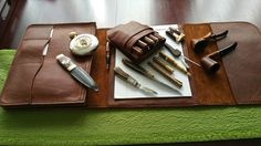 Renaissance Art pen pouch and folder holder with assorted gentlemans items; Laguiole knife Honour Durand, Masonic flask and Masonic officers kilt knife (full tanged and fully functional), fountain pens, pipe lighter and two reliable pipes.