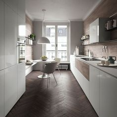 Amazing small kitchen and dining area in a minimalist space with warm herringbone pattern wood floor mixed with sleek cabinets