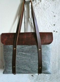 Striped purse with leather