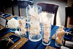 Florida beach wedding decor ideas a simple but elegant centerpiece love the use of the shells for a elegant oceanfront wedding junglespirit Image collections