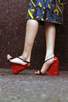 The shoes on Miuccia Prada's runway reflected her Constructivist mood for fall. Here, her sculpted wedges with red rubber soles. [Photo by Kuba Dabrowski]