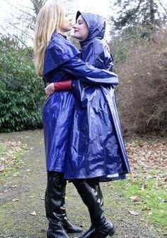 Two girls embracing in blue raincoats and black rubber boots Vinyl Raincoat, Green Raincoat, Raincoat Jacket, Plastic Raincoat, Hooded Raincoat, Black Rain Jacket, Rain Jacket Women, Lgbt, Rain
