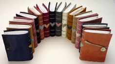 """November was all about production .... (and rather sore wrists) ....      Recycled leather """"Heart Books""""    Assorted recycled leather books ..."""