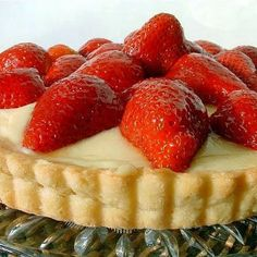 Shortbread crust, a pastry cream filling and fresh strawberries-- glazed with melted apricot jelly.