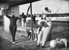 """OSKAR SCHLEMMER. """"Pantomime Treppenwitz"""", Werner Siedhoff, Oskar Schlemmer, Roman Clemens and Andor Weininger. Dessau, 1927. Photo: Erich Consemüller."""