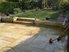 Fossil mint patio, sleeper walls and new lawn in Sheffield