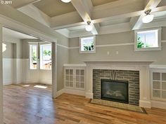 """Box-beam celing, oversized mantle, and built-ins... checked all the """"craftsman style"""" boxes I love!"""