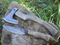 enter http://earth66.com/knife/forged-damascus-steel-knife-axe-combo/