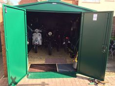 """Great to see an Asgard shed being used to house a classic motorcycles and scooter as well as a couple of bikes. This customer had some great things to say about his Motorcycle Storage Shed 9ft x 5ft 2"""" """"My Gladiator plus motorcycle store was delivered as arranged on August 15th. It arrived early but this was good. The boys were courteous and helpful teas were dispensed and this fantastic structure grew from lots of nuts and bolts and metal panels into the neatest bit of kit I've seen for a…"""