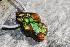 This site has AMAZING fire agate pendants, just what I was looking for!