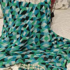 Calvin Klein Scarf/shawl Gorgeous geometric design. 28 x 72 blues black & greens Calvin Klein Accessories Scarves & Wraps