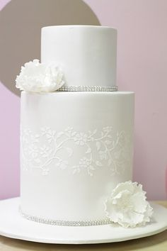 "Stunning simple white and rhinestone cake from the blog ""Hello Naomi"""