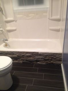 Remodeled the bathroom, but couldn't afford to replace the tub/surround so I added Airstone to the front for a spa look. I have received so many compliments. Quick, easy to install, fairly inexpensive.