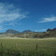 Gorgeous mountains and a green field as we were driving to Yellowstone. The sky was perfect.
