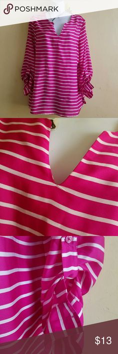 Beautiful  bright number This top has a v neck line with two small splits at side .semi sheer ,kind of a fushia pink in color length 29 width 20 Ann Taylor Tops Blouses