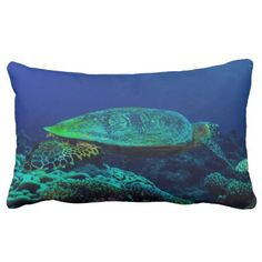 This throw pillow features a critically endangered Hawksbill Sea Turtle, distinguished from other sea turtles by its sharp, curving beak, swimming in the blue waters of the Coral Sea on Australia's Great Barrier Reef.