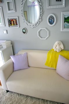 frame collage wall, ikea couch, mirror, nursery