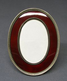 Picture frame by Carl Fabergé, workmaster: Henrik Emanuel Wigström, in silver-gilt with red guilloche enamel and ivory back Antique Picture Frames, Antique Frames, Famous Jewelers, Russian Jewelry, Mirror Painting, Faberge Eggs, Jewels, Antiques, Saint Petersburg