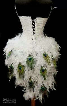 I don't particularly like this dress, but love the idea of the peacock feathers