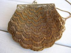 Bronze beaded shell shaped clutch with chain strap