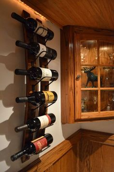 Wine Stave Wine rack by WineStaveCrafts on Etsy, $85.00.....  Great idea so I can get rid of my floor rack....