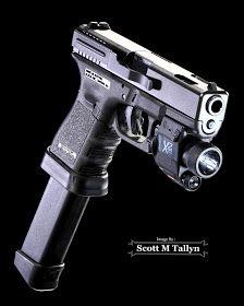 Glock 19C w/ Insight X2 Laser/Flash Light & 33 Rnd. Magazine by Scott M Tallyn
