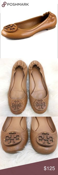 Tory Burch Pebbled Leather Reva Flats Size 7 Such a classic and beauty to own! These tumbled leather Tory Burch flats feature a cutout logo medallion at the vamp and gathered elastic banding at the back. Topstitched top line. Padded footbed and rubber sole. Please see photos for any wears! Happy Poshing! Tory Burch Shoes Flats & Loafers