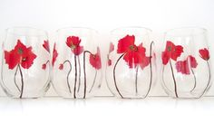 """These vibrant red poppies just PoP with red and bright golden dotted centers. They carry the beautiful """"papery, flowy"""" features that are so true of authentic poppy flowers. MEMBER - Swirly Garden"""