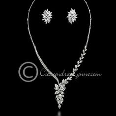 A unique asymmetrical bridal jewelry set design of marquise CZ jewels. Earrings are approximately 1 inch long, post backs, the necklace is 16 inches with a lock